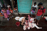 Children watch as a man butchers a cow on the street for the annual religious festival of Eid al-Adha in Dakha, Bangladesh. Bangladesh has the world's fourth largest Muslim population, and during the three days of Eid al-Adha, the Festival of Sacrifice, Dhaka's streets run red with the blood of thousands of butchered cattle. The feast comes at the conclusion of the Hajj, the annual Islamic pilgrimage to Mecca. In both the Koran and the Bible, God told the prophet Ibrahim (Abraham) to sacrifice his son to show supreme obedience to Allah (God). At the last moment, his son was spared and Ibrahim was allowed to sacrifice a ram instead. In Dhaka, as in the rest of the Muslim world, Eid al- Adha commemorates this tale, and the meat of the sacrificed animals is distributed to relatives, friends, and the poor.