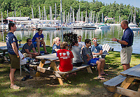 Lake Winnipesaukee Sailing Association Director Anthony Sparazzo and Bob Garland talk with their instructors lake side as they prepare for the 2015 season.(l-r back row) instructors Chris Yopp, Morgan Himmer, Dawson Ellis, Catherine McLaughlin, Ben Crosby Jr. Director and Liam Shanahan Jr.<br /> l-r front row) Wyatt Himmer, Elizabeth McCabe and Samih Shafique.   Director.  (Karen Bobotas/for the Laconia Daily Sun)