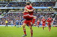 Middlesbrough FC midfielder Grant Leadbitter, Middlesbrough FC defender Daniel Ayala and Middlesbrough FC midfielder Albert Adomah celebrate the second goal during the Sky Bet Championship match between Brighton and Hove Albion and Middlesbrough at the American Express Community Stadium, Brighton and Hove, England on 19 December 2015. Photo by Phil Duncan.