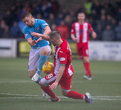 Forfar Athletic's John Baird  and East Fife's Kevin Smith. Forfar Athletic 3 v 0 East Fife, Scottish Football League Division One game played 2/3/2019 at Forfar Athletic's home ground, Station Park, Forfar.