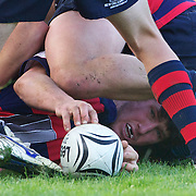 Ben Chisholm of Arrowtown releases the ball after being tackled   during the Wakatipu V Arrowtown Rugby Match at Queenstown Recreation Ground,  Queenstown, South Island, New Zealand, 11th June 2011