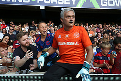 2 September 2017 - Charity Football - Game 4 Grenfell - Team Shearer goalkeeper Jose Mourinho sits on the advertising boards to interact with fans - Photo: Charlotte Wilson