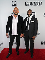 David Harris Jr., and  M. Adrian Norman at Death Of A Nation Los Angeles Premiere held at Regal L.A. Live: A Barco Innovation Center on July 31, 2018 in Los Angeles, California, United States (Photo by Jc Olivera for Jade Umbrella)