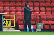 AFC Wimbledon manager Wally Downes with arms crossed during the EFL Sky Bet League 1 match between Charlton Athletic and AFC Wimbledon at The Valley, London, England on 15 December 2018.