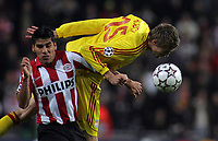 Photo: Paul Thomas.<br />PSV Eindhoven v Liverpool. UEFA Champions League, Quarter Final, 1st Leg. 03/04/2007.<br /><br />Peter Crouch (R) of Liverpool battles Carlos Salcido.