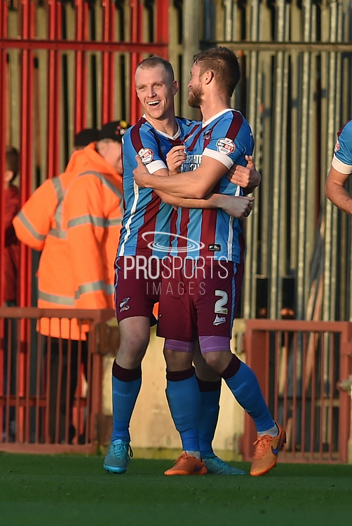 Tom Hopper of Scunthorpe United  and Scott Wiseman of Scunthorpe United celebrate scunthorpes second goal to go 2-0 p during the Sky Bet League 1 match between Scunthorpe United and Barnsley at Glanford Park, Scunthorpe, England on 31 October 2015. Photo by Ian Lyall.