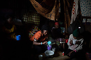 A woman prepares breakfast for her family who share a small room in the slum of Korogocho close to the rubbish dump of Dandora in the capital Nairobi, Kenya, February 21, 2019. Fifteen people between children and adults share this small space in a rented room in the slum of Korogocho. All the adults of the family work and make daily living in the rubbish dump of Dandora.