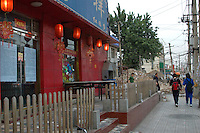 China, Beijing, Chaoyang, San Jian Fang, 2008. A restaurant makes a public protest against being evicted. Hundreds of small businesses along Chaoyang Street have been demolished to the east and west of this corner..