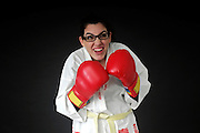 female Wimp tries to box On black Background