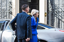 """London, UK. 21 May, 2019. Prime Minister Theresa May arrives at 10 Downing Street following a Brexit statement during which she advised MPs that the EU Withdrawal Agreement Bill presented """"one last chance"""" to deliver Brexit and that MPs will be able to vote on whether to hold another referendum if they back the bill. The bill as presented also contains new guarantees on workers' rights, environmental protections and the Irish backstop together with a """"compromise"""" regarding customs."""