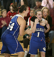 Wallkill's Katlyn Ponesse, left, Raven Pentz (1)  and Kelly Warren, rear, celebrate after their team defeated John A. Coleman 36-34 in the Mid-Hudson Athletic League championship game at Ulster County Community College in Stone Ridge on Friday, Feb. 18, 2011. Warren did not play in the game because she is injured.