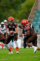 KELOWNA, BC - SEPTEMBER 8:   Quarterback Alex Douglas #1 hands the ball off to running back Malcolm Miller #3 of Okanagan Sun against the Langley Rams at the Apple Bowl on September 8, 2019 in Kelowna, Canada. (Photo by Marissa Baecker/Shoot the Breeze)