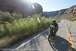 Paul Ousey riding his 1925 Harley-Davidson JE on the two-lane Utah Highway 128 along the Colorado River south toward Moab during stage 11 (289 miles) of the Motorcycle Cannonball Cross-Country Endurance Run, which on this day ran from Grand Junction, CO to Springville, UT., USA. Tuesday, September 16, 2014.  Photography ©2014 Michael Lichter.