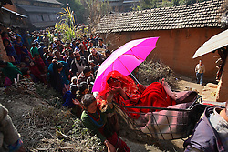 Sumeena Shreshta Balami, 15, cries as the wedding procession leads her to her new husband's home in Kagati Village, Kathmandu Village, Nepal on Jan. 24, 2007. The harmful traditional practice of early marriage is common in Nepal. The Kagati village, a Newar community, is most well known for its propensity towards this practice. Many Hindu families believe blessings will come upon them if marry off their girls before their first menstruation.