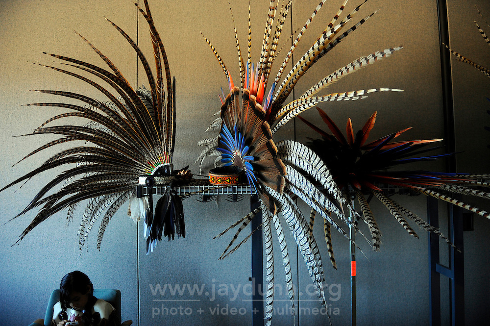 """Headdresses ready before a performance on September 9th, 2012 at Fiesta del Mar at the Monterey Bay Aquarium. By teaching their children traditional dances and conduct, members of the Yaocuauhtli - Eagle Warrior """"calpulli,"""" or group, are preserving a proud ethnic heritage."""