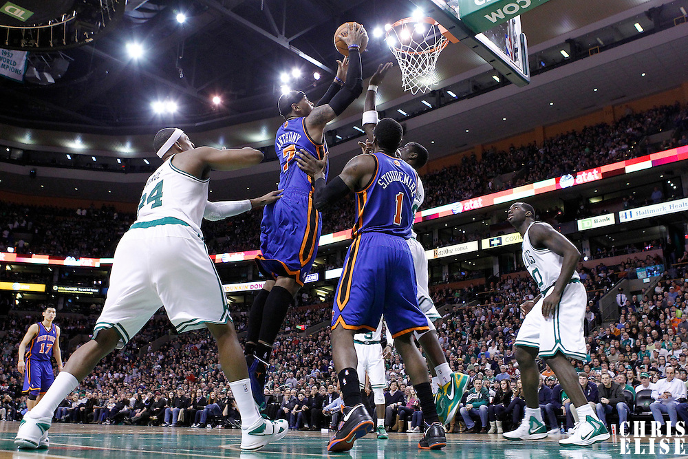 04 March 2012: New York Knicks small forward Carmelo Anthony (7) goes for the layup against Boston Celtics small forward Mickael Pietrus (28) during the Boston Celtics 115-111 (OT) victory over the New York Knicks at the TD Garden, Boston, Massachusetts, USA.