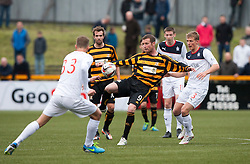 Alloa Athletic's Andy Kirk and Falkirk's Stephen Kingsley.<br /> Alloa Athletic 0 v 0 Falkirk, Scottish Championship 12/10/2013. played at Recreation Park, Alloa.<br /> ©Michael Schofield.