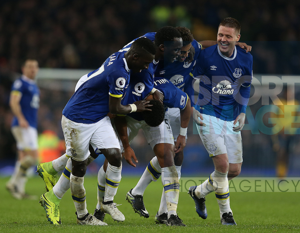 Ashley Williams of Everton is mobbed after scoring the winning goal  during the English Premier League match at Goodison Park Stadium, Liverpool. Picture date: December 13th, 2016. Pic Simon Bellis/Sportimage