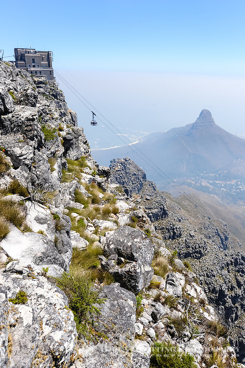 Table Mountain is a flat mesa  overlooking the city of Cape Town in South Africa. Lion's Head to the west.