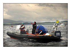 470 Class European Championships Largs - Day 1.Racing in grey and variable conditions on the Clyde...Mark boat displaying change of course