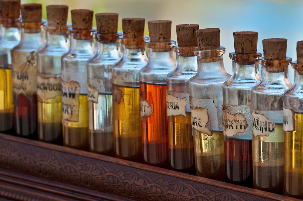 Antique bottles of essentil fragances and oils lined up. fragances and oils lined up.