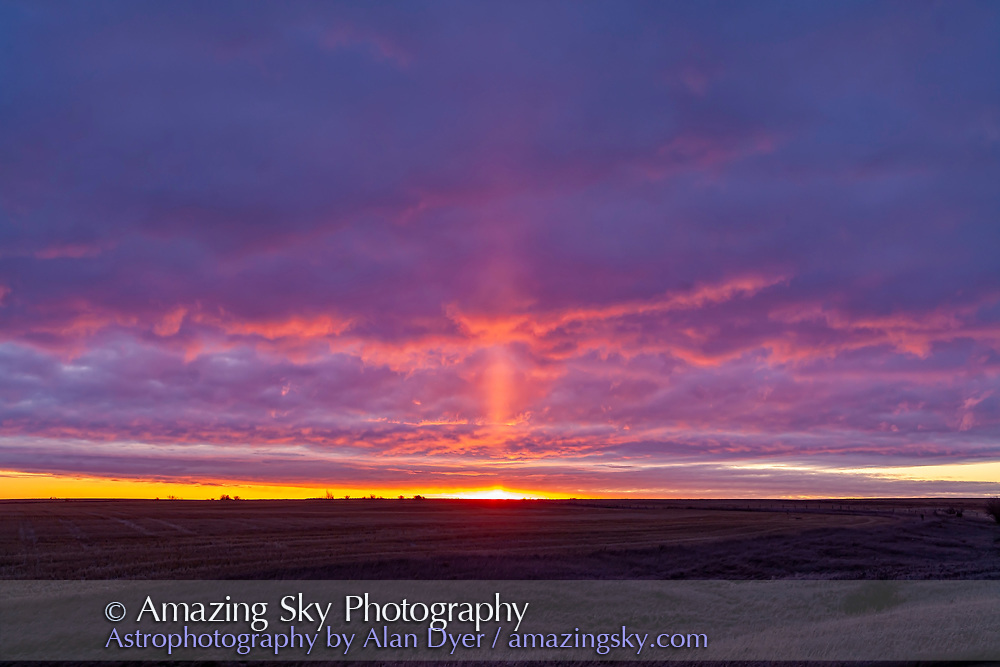 A light pillar off the rising Sun, from home on October 27, 2019. This is caused by light reflecting off flat ice crystals in the air on this frosty fall morning. <br /> <br /> A single shot with the 50mm Sigma lens and Canon 5D MkII.