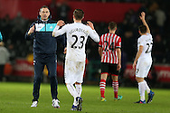 Swansea city manager Paul Clement winks at goal scorer Gylfi Sigurdsson of Swansea city at the end of the game after they win 2-1. Premier league match, Swansea city v Southampton at the Liberty Stadium in Swansea, South Wales on Tuesday 31st January 2017.<br /> pic by  Andrew Orchard, Andrew Orchard sports photography.