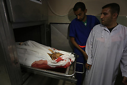 June 13, 2017 - Gaza City, Gaza Strip, Palestinian Territory - Relatives of Palestinian Aaed Goma react upon the arrival of his body outside a hospital morgue in the northern Gaza Strip June 9, 2017  (Credit Image: © Mohammed Asad/APA Images via ZUMA Wire)