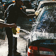 Two men washing a car in the downtown area of Buenos Aires, Argentina.