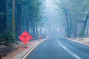 A sign alerts drivers to a management fire causing smoke in Yosemite National Park.