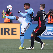 NEW YORK, NEW YORK - March 12:  Ethan White #3 of New York City FC is challenged by Patrick Mullins #16 of D.C. United during the NYCFC Vs D.C. United regular season MLS game at Yankee Stadium on March 12, 2017 in New York City. (Photo by Tim Clayton/Corbis via Getty Images)