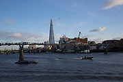 View along the River Thames across the Millennium Bridge towards The Shard, London, UK.