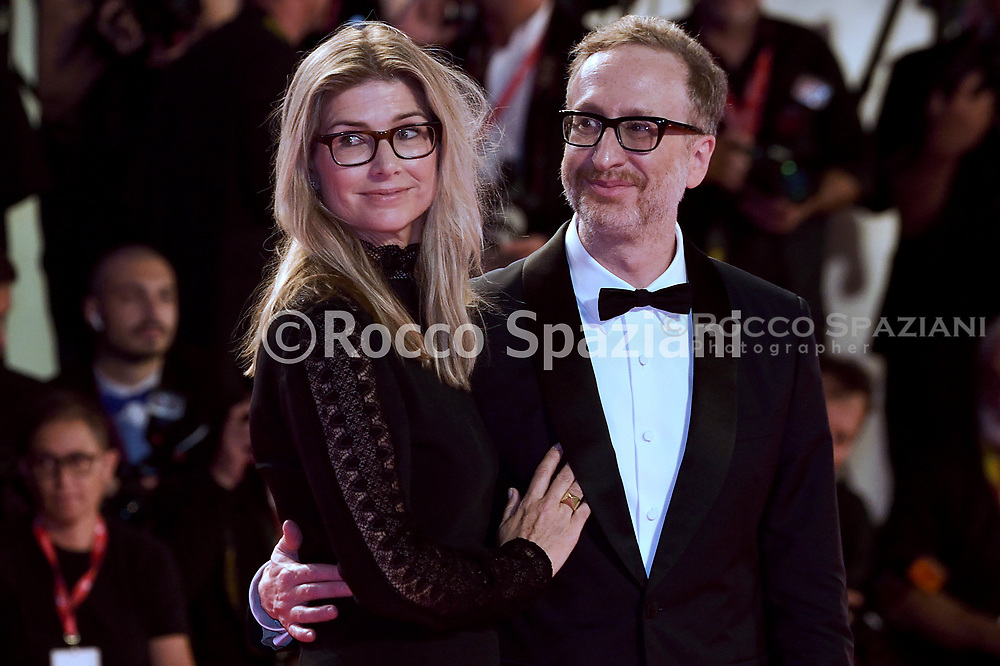 """ENICE, ITALY - AUGUST 29: (R) Director James Gray and his wife Alexandra Dickson Gray walk the red carpet ahead of the """"Ad Astra"""" screening during during the 76th Venice Film Festival at Sala Grande on August 29, 2019 in Venice, Italy."""