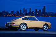Image of a tan sports car and the Seattle skyline in Seattle, Washington, Pacific Northwest, Porsche 1967 911S, property released