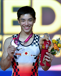 Kenzo Shirai of Japan poses with his silver medal on the podium after winning the men's Floor Exercise Final at the 48th Gymnastics World Championships in Doha, capital of Qatar, Nov. 02, 2018. Kenzo Shirai won the silver medal with 14.866  (Credit Image: © Yangyuanyong/Xinhua via ZUMA Wire)