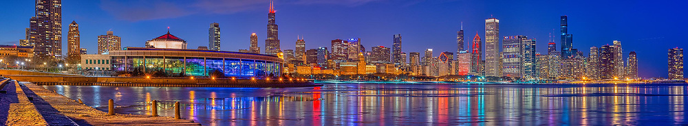 Chicago's magnificent architectural skyline illuminated on a February evening from the lakefront. In recognition of the 2020 NBA All Star Game taking place in Chicago. Exterior Architectural Photography. Buildings, locations, architecture. Chicago, Illinois, built landscape,