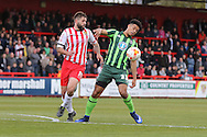 Lyle Taylor forward for AFC Wimbledon (33) and Dean Wells defender for Stevenage FC (19)  during the Sky Bet League 2 match between Stevenage and AFC Wimbledon at the Lamex Stadium, Stevenage, England on 30 April 2016. Photo by Stuart Butcher.
