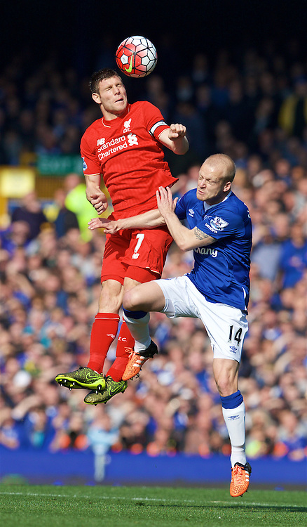 LIVERPOOL, ENGLAND - Sunday, October 4, 2015: Liverpool's James Milner in action against Everton's Steven Naismith during the Premier League match at Goodison Park, the 225th Merseyside Derby. (Pic by David Rawcliffe/Propaganda)