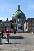 Amalienborg or Royal Palace courtyard with dome of Marble church (Frederik's Church) in the background. Copenhagen, Denmark