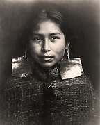 Tsawatenok girl, head-and-shoulders portrait, facing front, c1914.  Photograph by Edward Curtis (1868-1952).