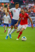 Jason Sancho of England and Anton Nedyalkov of Bulgaria during the UEFA European 2020 Qualifier match between England and Bulgaria at Wembley Stadium, London, England on 7 September 2019.