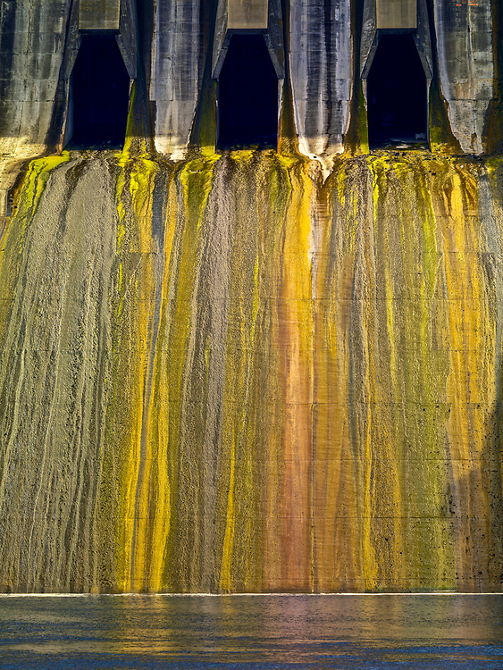 Editions of 17<br /> Oxbow Dam Spillway on the Hells Canyon section of the Snake River spans from Idaho to Oregon with mossy streaks creating a colorful striated vertical pattern. Licensing on Limited Edition Prints