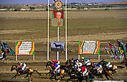 Ashgabat, Turkmenistan, October 1997..Horse racing is the national sport in Turkmenistan. At the national stadium the winning post is decorated with a portrait of President Saparmurat Niyazov and quotes from his writings. Poverty-stricken, but rich in oil and gas resources, this Central Asian former Soviet republic is ruled by the autocratic President Saparmurat Niyazov, or Turkmenbashi as he has renamed himself...............