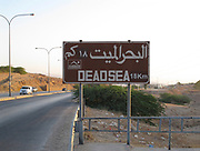 Road sign in Jordan showing the way to the Dead Sea