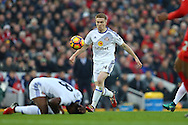 Duncan Watmore of Sunderland plays on while his teammate Jermain Defoe lies injured.  Premier League match, Liverpool v Sunderland at the Anfield stadium in Liverpool, Merseyside on Saturday 26th November 2016.<br /> pic by Chris Stading, Andrew Orchard sports photography.