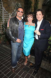 Left to right, ADAM BRICUSSE, JOAN COLLINS and her son SACHA NEWLEY at a private view of work by Sacha Newley entitled 'Blessed Curse' in association with the Catto Gallery held at the Arts Club, Dover Street, London W1 on 2nd July 2008.<br /> <br /> NON EXCLUSIVE - WORLD RIGHTS