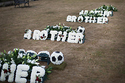 © Licensed to London News Pictures. 04/09/2016. London, UK. Floral tributes are laid out at a traditional Hindu funeral held at Winn's Common Park for five men who drowned at Camber Sands last month.  The five men: Kurushanth Srithavarajah, brothers  Kenigan and Kobi Nathan, Inthushan Sri and Nitharsan Ravi were all friends from London.  They got into difficulty in the sea of Camber Sands on August 24. Photo credit: Peter Macdiarmid/LNP