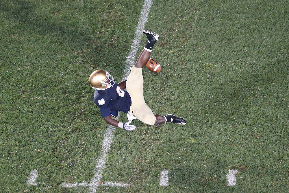 Notre Dame wide receiver Theo Riddick (#6) attempts to catch pass in action during NCAA football game between Notre Dame and South Florida.  The South Florida Bulls defeated the Notre Dame Fighting Irish 23-20 in game at Notre Dame Stadium in South Bend, Indiana.