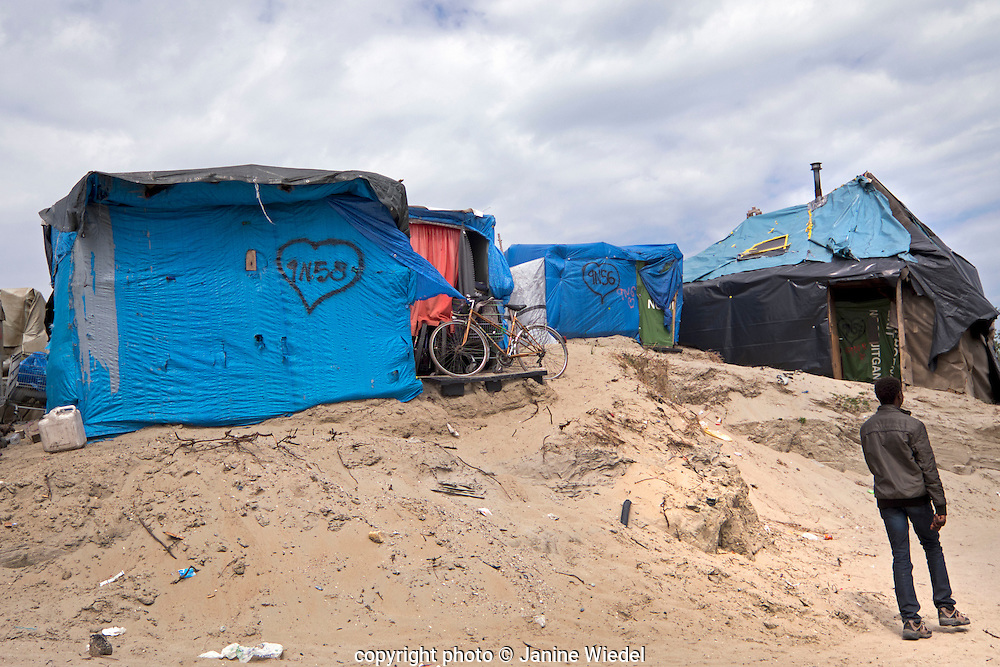 Makeshift accommodation of tents and wooden structures in The Calais Jungle Refugee and Migrant Camp in France