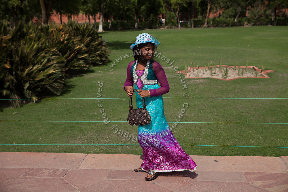 A young Indian girl enjoying a day at the Taj Mahal building, in Agra.